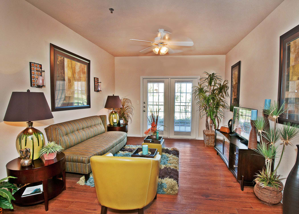 Well-decorated open-concept living area in model home at Trails at Buda Ranch in Buda, Texas