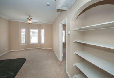 Ceiling fan and built-in bookshelves in open-concept floor plan at Rosemont at Olmos Park in San Antonio, Texas