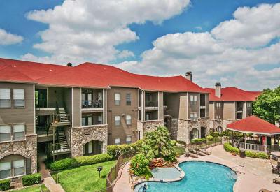 Resident buildings, pool area, and gazebo at Rosemont at Olmos Park in San Antonio, Texas