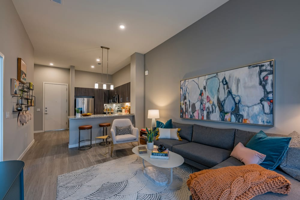A spacious living room with wood-style flooring at Encore Tessera in Phoenix, Arizona