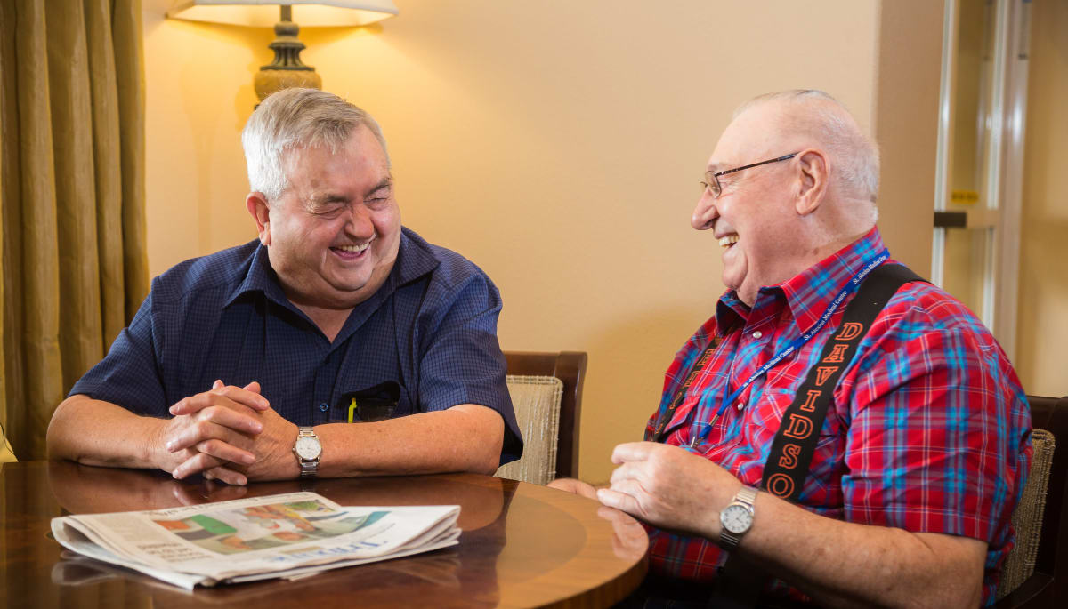 Residents laughing and enjoying each other at Touchmark on West Century in Bismarck, North Dakota