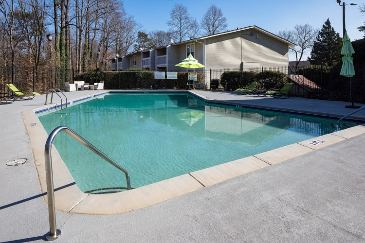 Swimming pool area at Premier Apartments in Austell, Georgia