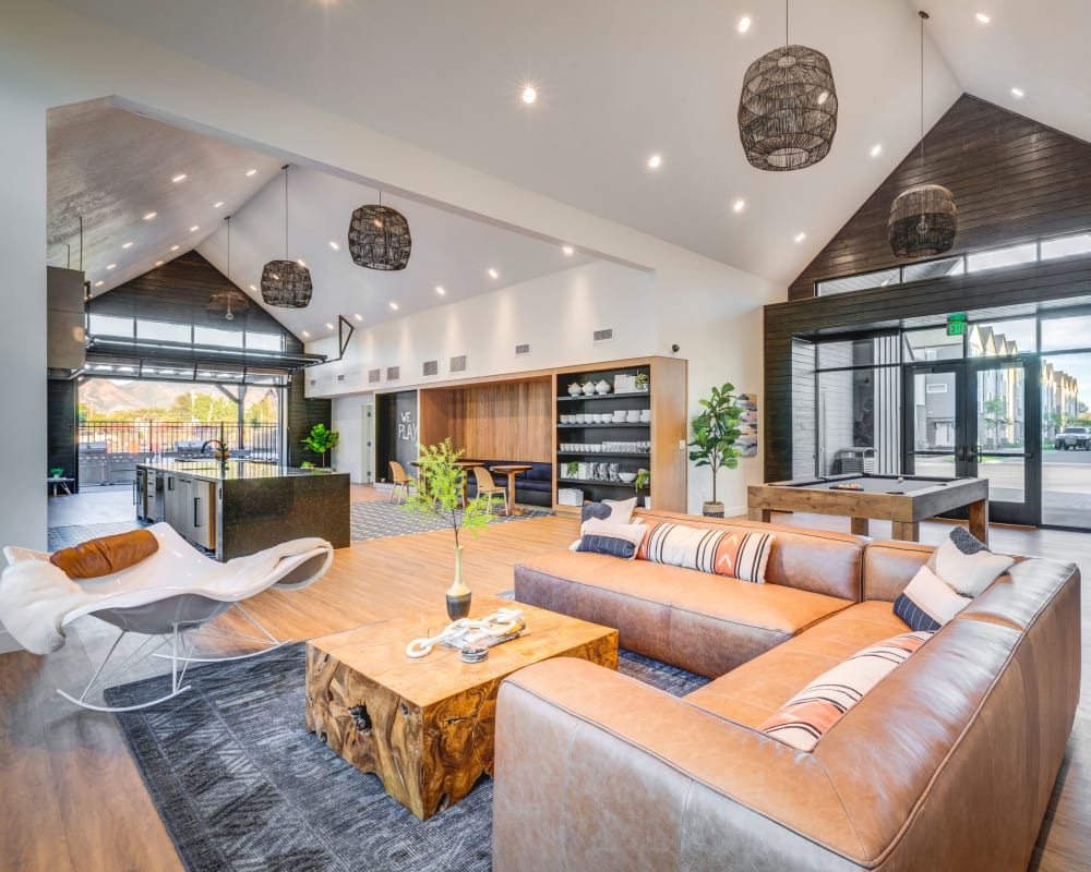 A large open clubhouse with plenty of comfortable seating at Hawthorne Townhomes in South Salt Lake, Utah