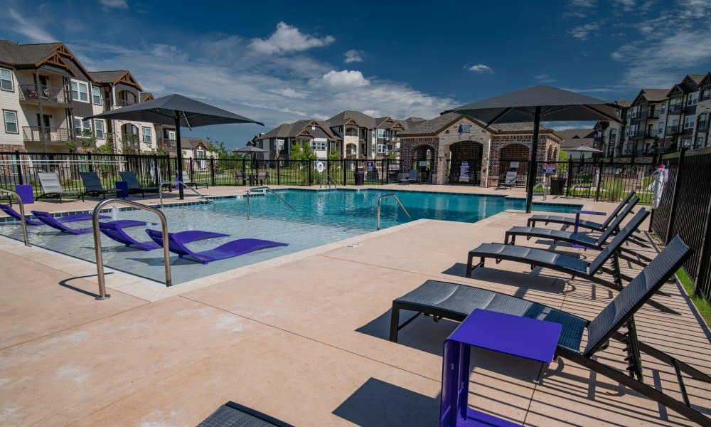 Resort-style pool with cabana area at Cedar Ridge in Tulsa, Oklahoma