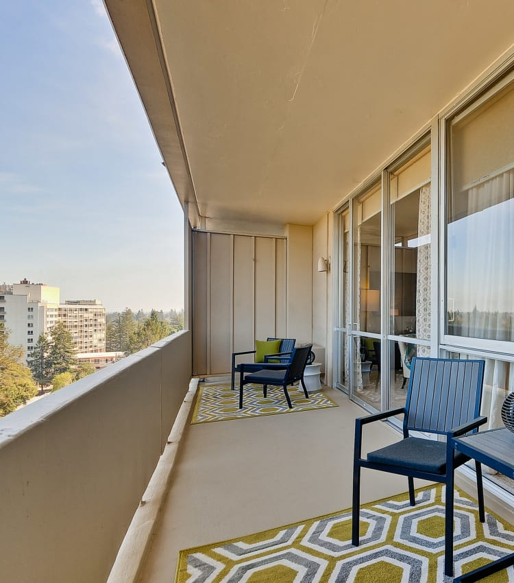 Spacious balconies with treeline views at The Marc, Palo Alto in Palo Alto, California