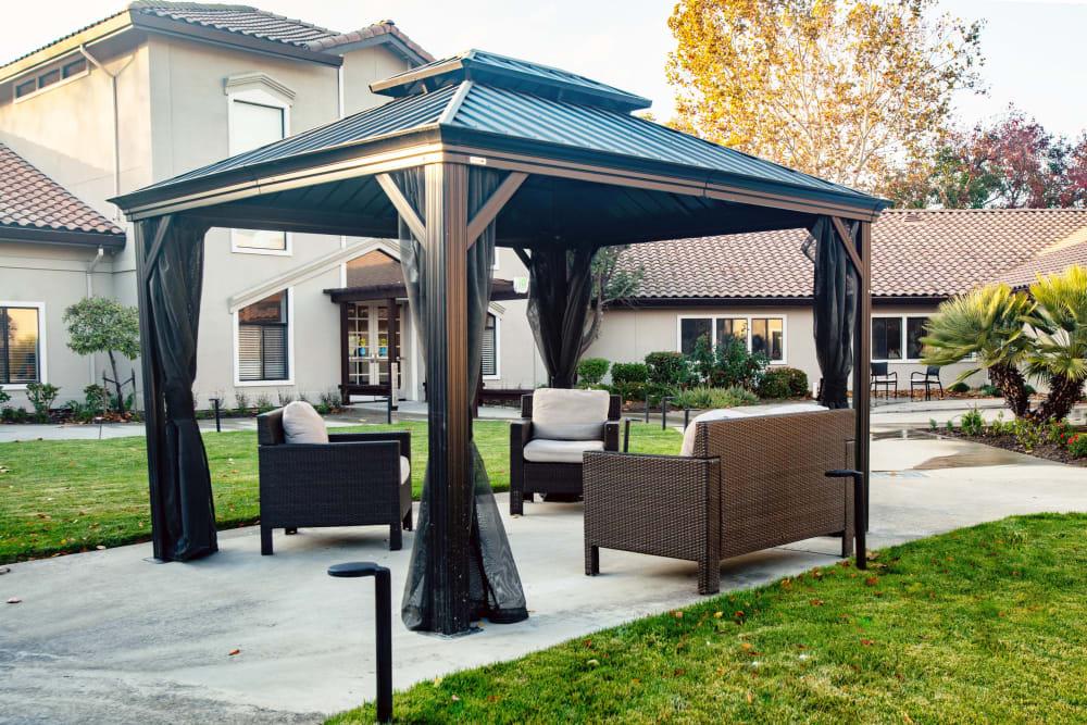 Covered outdoor seating at Carefield Pleasanton in Pleasanton, California