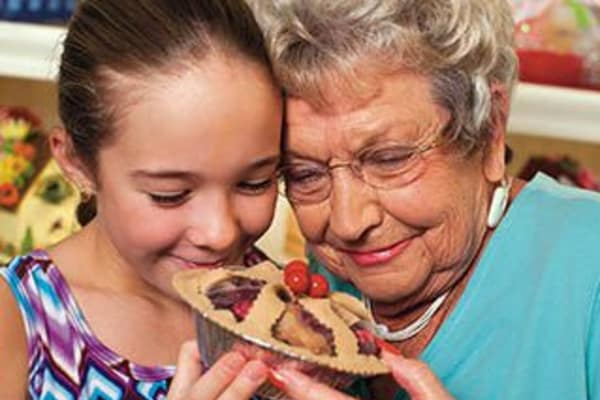 Grandmother and granddaughter share a pie at Discovery Commons At Spring Creek in Garland, Texas