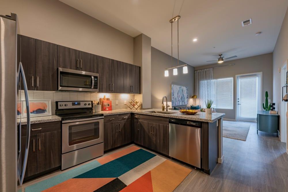 Kitchen with granite countertops at Encore Tessera in Phoenix, Arizona