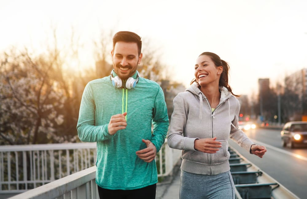 Residents going for a morning jog near Sofi at 3rd in Long Beach, California