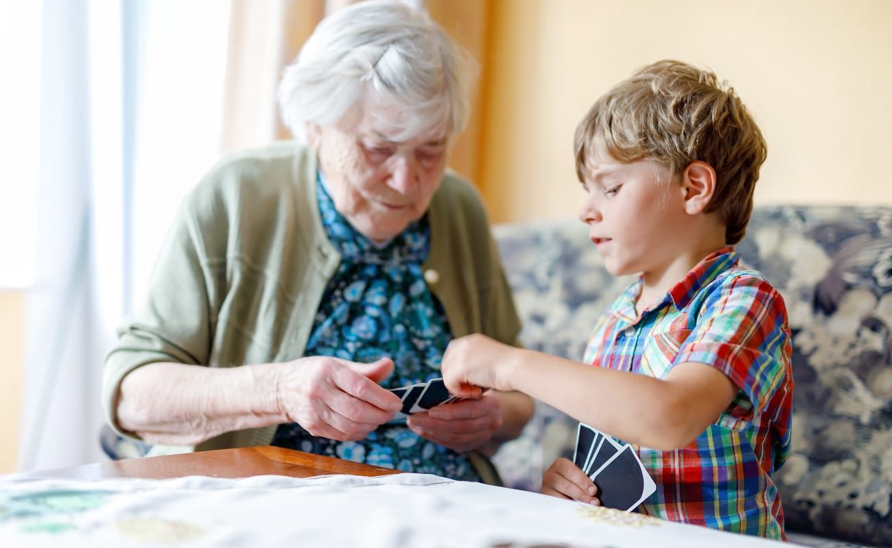 A resident and young boy working playing a game at Pine Rock Manor in Warner, New Hampshire.