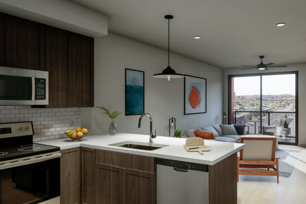 Contemporary kitchen with stainless-steel sink at The Astor at Osborn in Phoenix, Arizona
