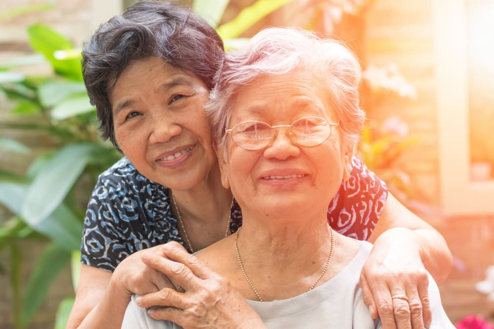 Senior Asian woman with adult daughter