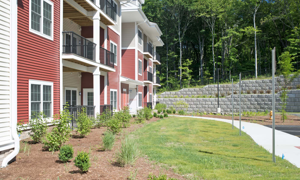 Paved walkway around resident apartment buildings at Keystone Place at Newbury Brook in Torrington, Connecticut