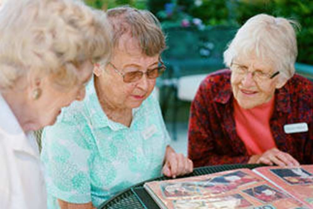 Residents looking through an album at Merrill Gardens.