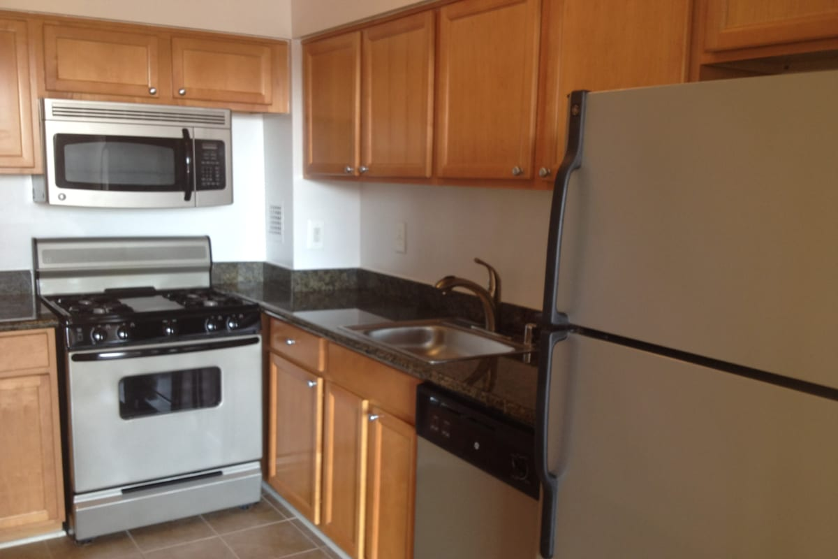 A kitchen with plenty of cabinet space at Bethesda from your living room at Westwood Tower Apartments in Maryland
