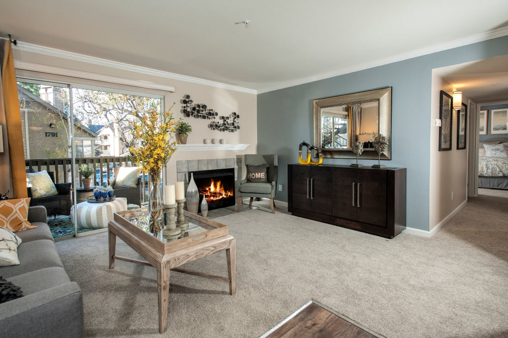 A spacious living room with plush carpeting at Mill Springs Park Apartment Homes in Livermore, California