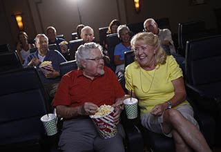 Seniors in the movie theater at Discovery Commons At College Park in Indianapolis, Indiana