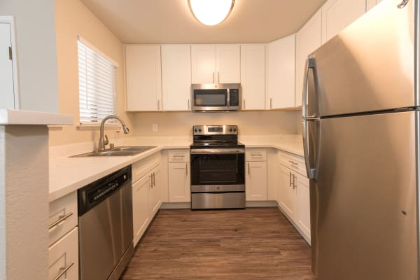 Kitchen with white cabinetry and stainless-steel appliances at Park Ridge Apartment Homes in Rohnert Park, California