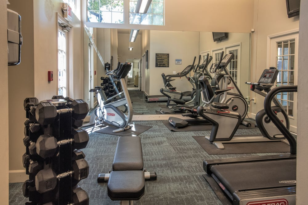 A fitness center at Mill Springs Park Apartment Homes in Livermore, California