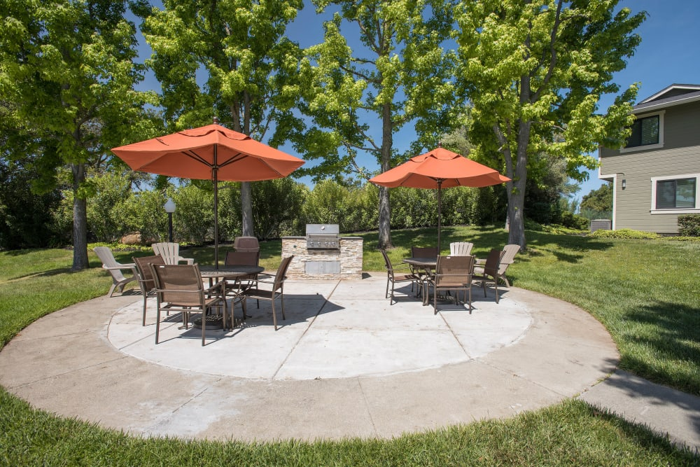 Picnic area with a BBQ station at Ridgecrest Apartment Homes in Martinez, California