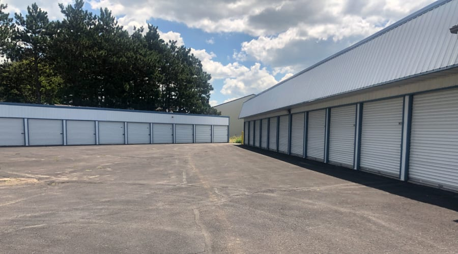 Exterior view of storage units with white doors at KO Storage of Becker in Becker, Minnesota