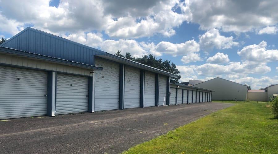 Outdoor storage units next to a lawn at KO Storage of Becker in Becker, Minnesota
