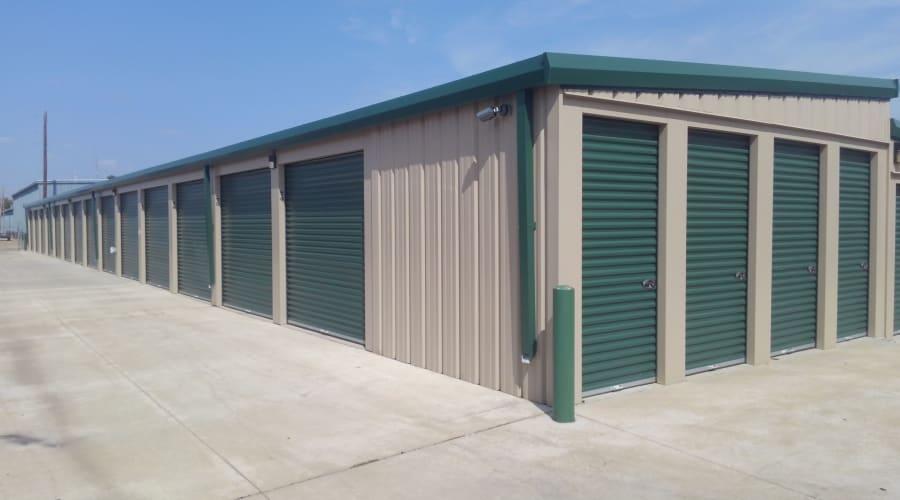 Storage units with green doors at KO Storage of Salina - Clark in Salina, Kansas