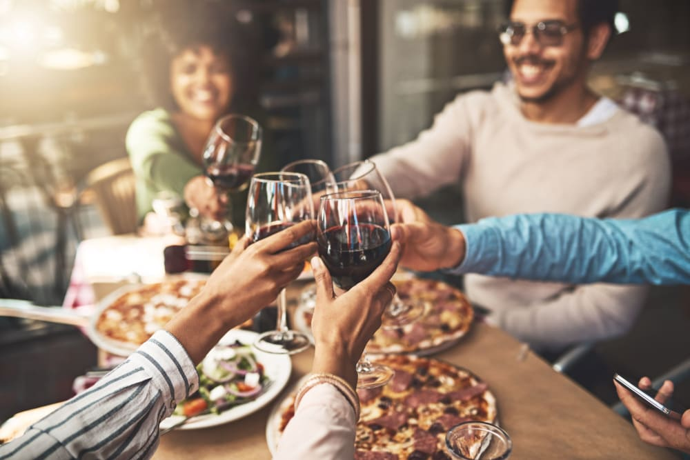 Friends enjoying wine and pizza at Integra Crossings in Sanford, Florida