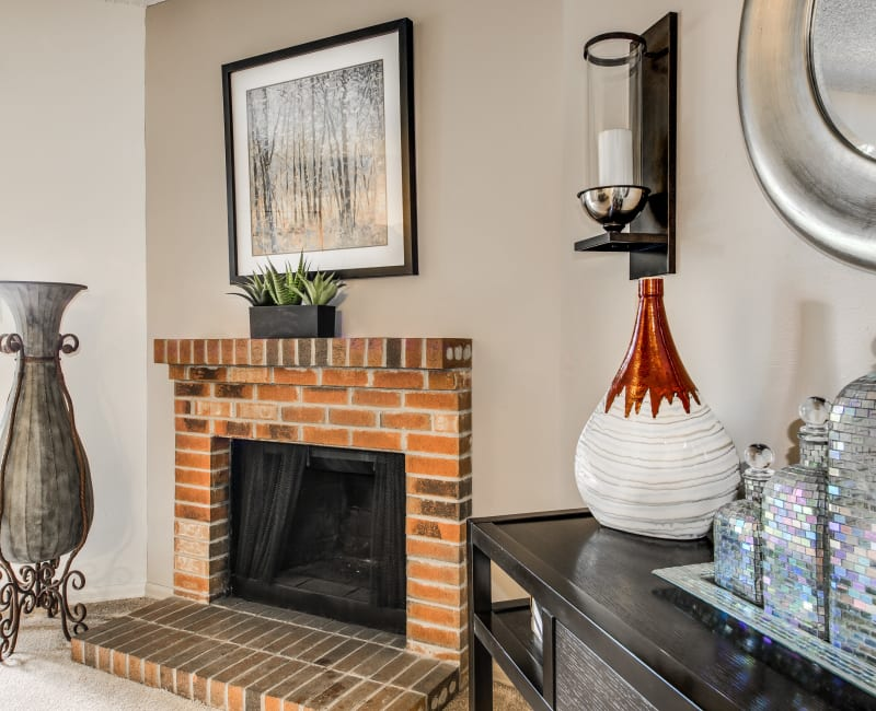 Wood-burning fireplace in a well-decorated model home's living area at Santana Ridge in Denver, Colorado