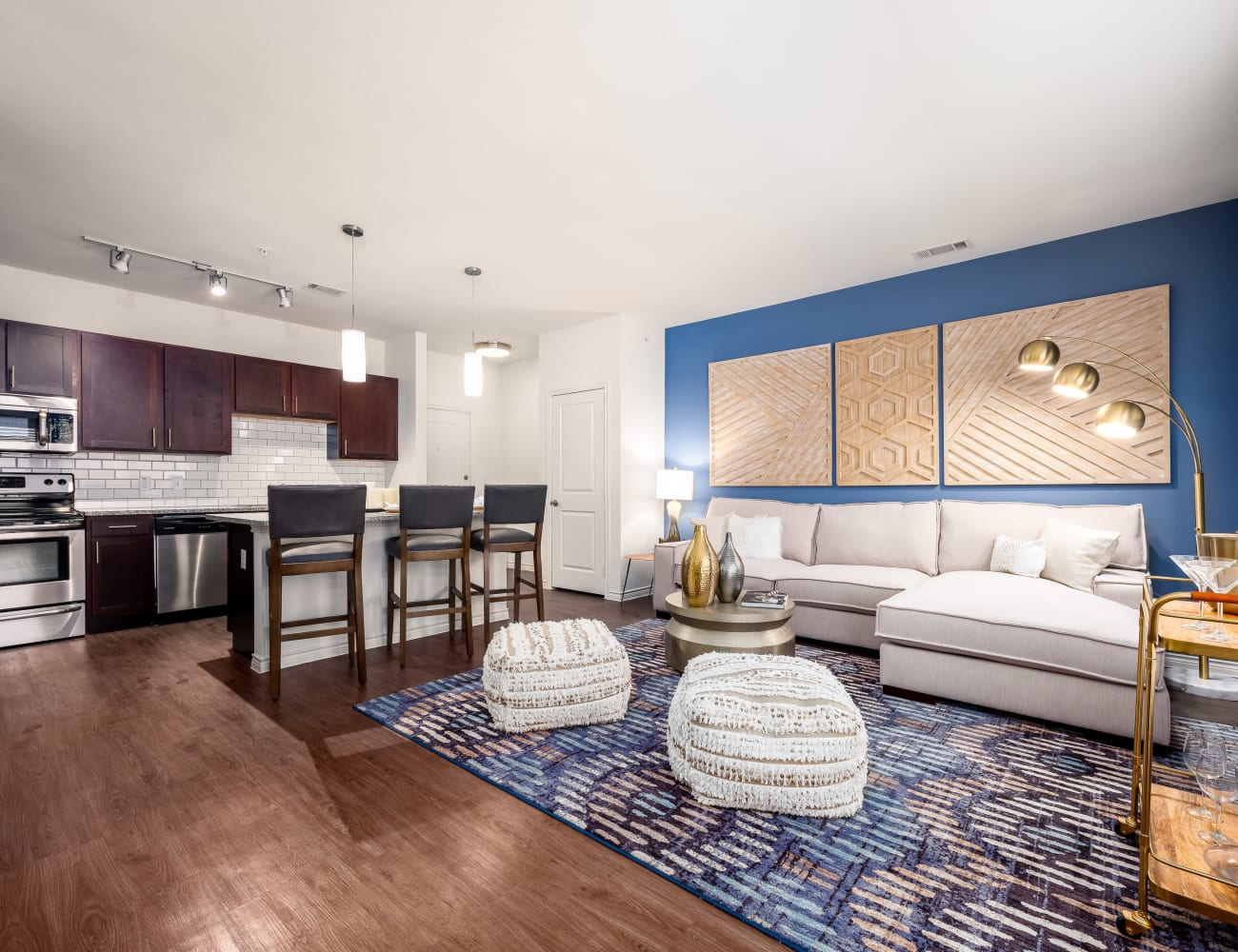Open-concept layout with hardwood floors at Four Corners Apartments in Frisco, Texas