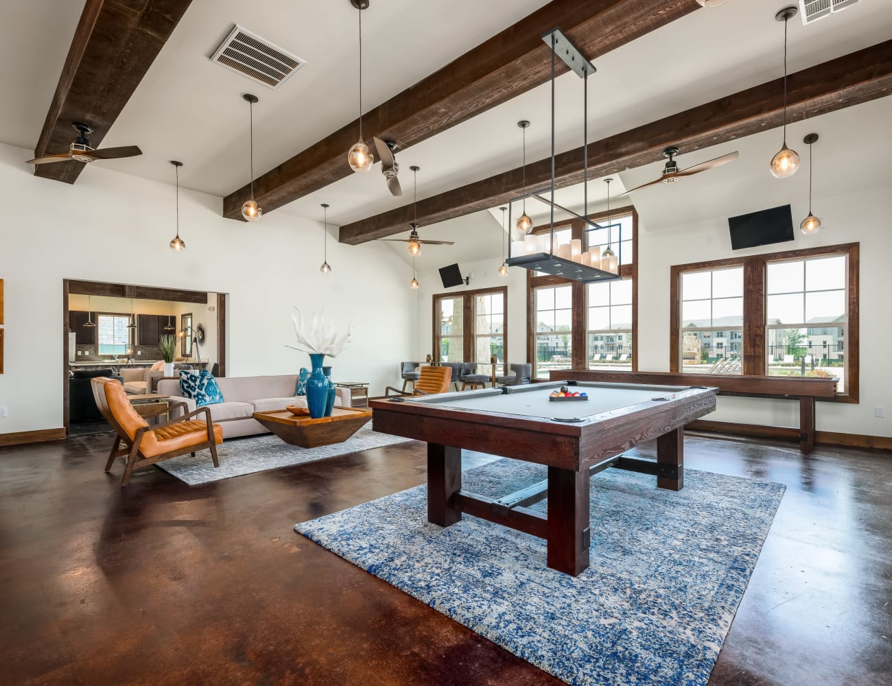 Resident clubhouse with billiards table and more at Four Corners Apartments in Frisco, Texas