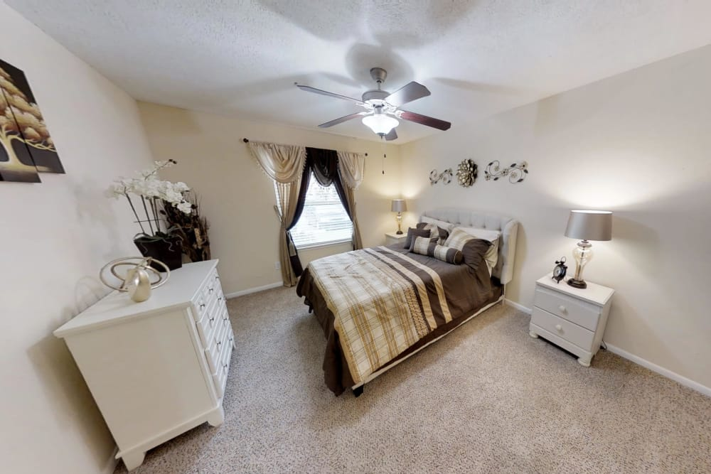 Sun-lit bedroom at Cedar Ridge Apartments