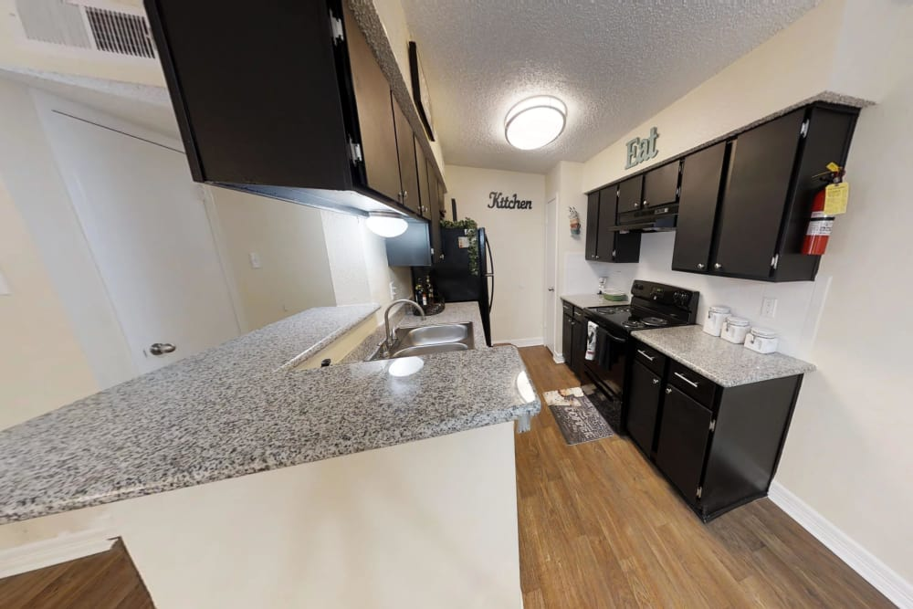 Well-lit kitchen at Westwood Village Apartments in Rosenberg, TX