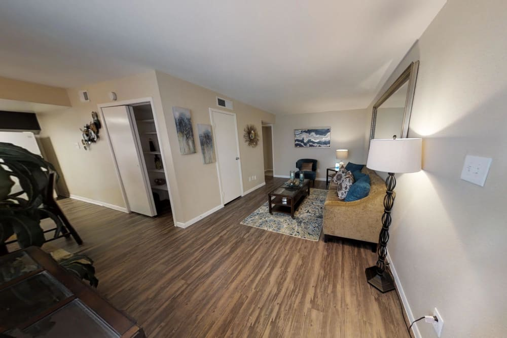 Waterchase Apartments offers a beautiful living room in Humble, Texas