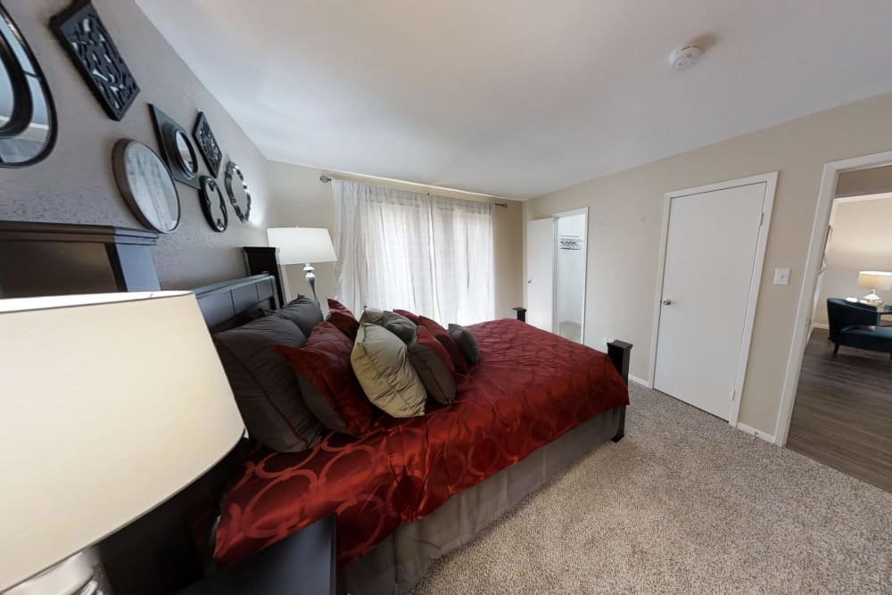 Waterchase Apartments offers a cozy bedroom in Humble, Texas