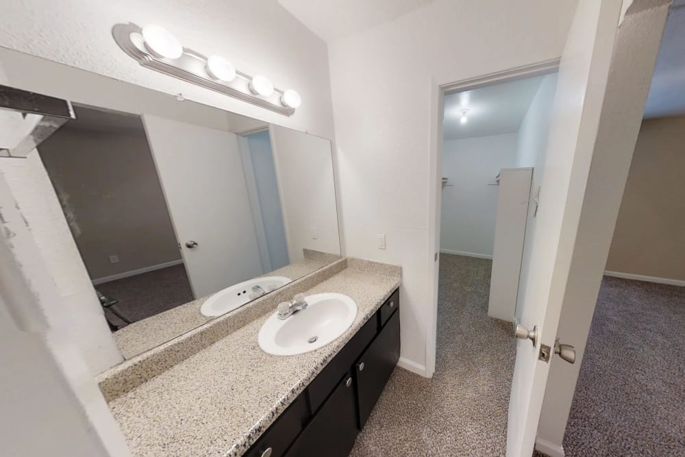 Bathroom at Meadow Park Apartments in Alvin, Texas