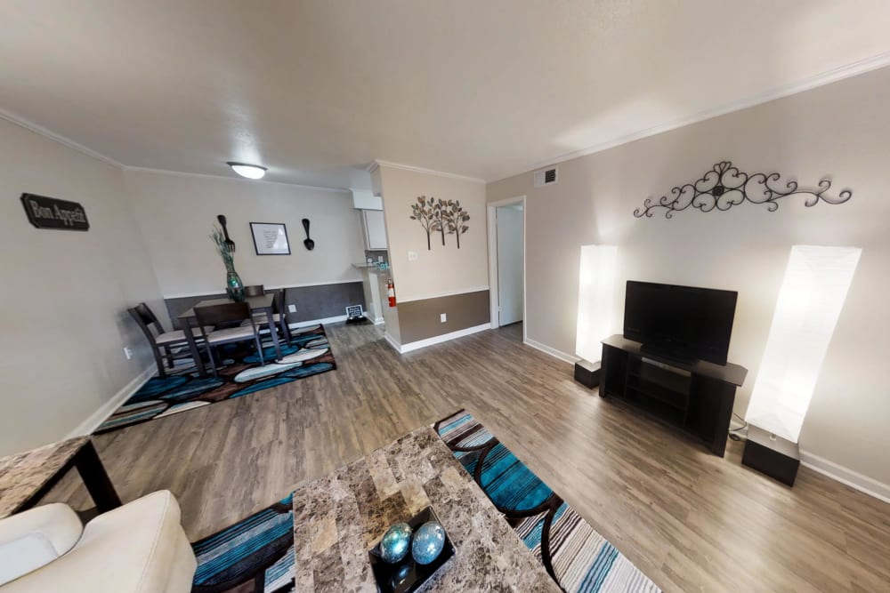Well-lit Living Room at Falls of Maplewood Apartments in Houston, Texas