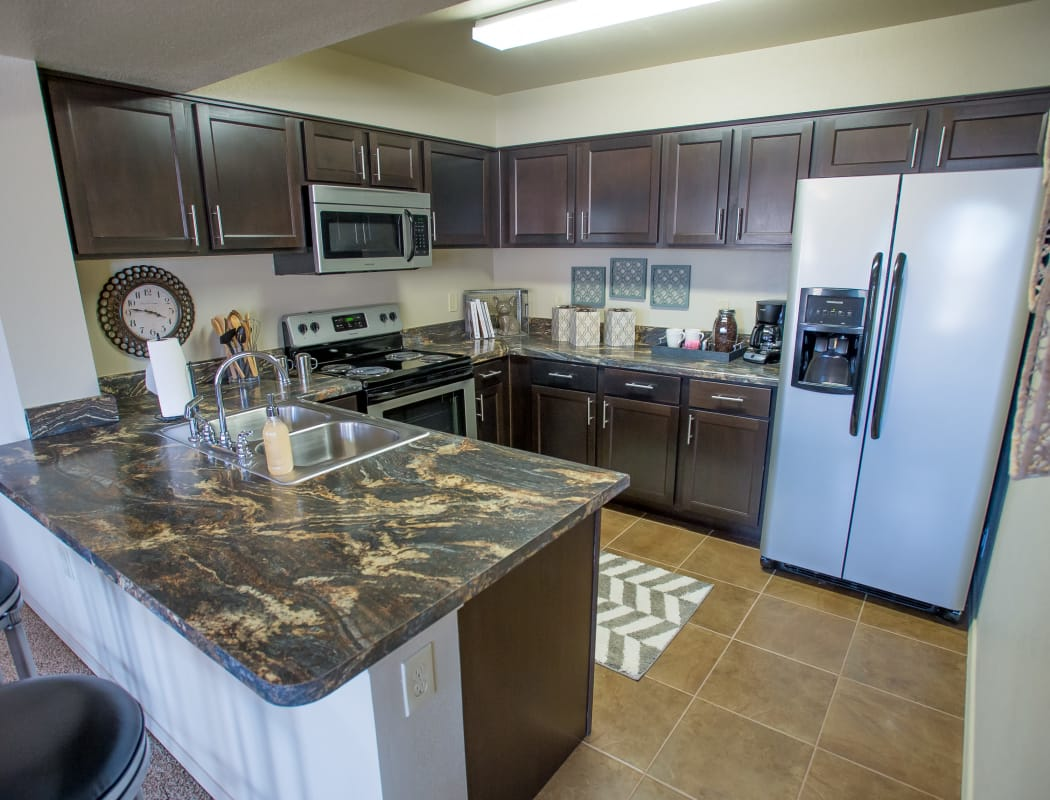 Fully equipped kitchen at Mission Point Apartments in Moore, Oklahoma