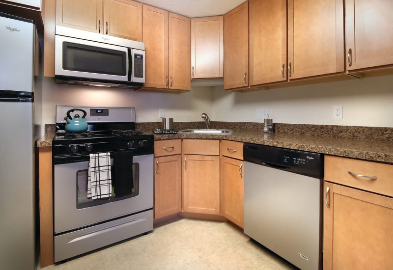 Kitchen with stainless steel appliances at Middlesex Crossing in Billerica, Massachusetts