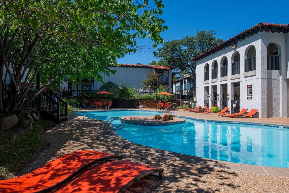 Poolside seating at Barcelona Apartments in Tulsa, Oklahoma