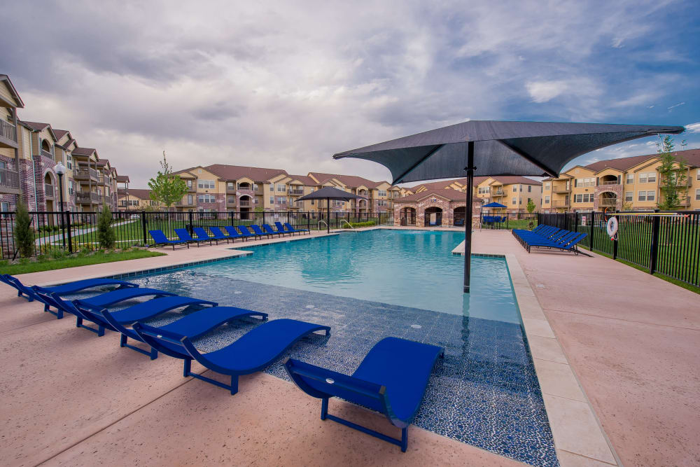 Poolside seating at Watercress Apartments in Maize, Kansas