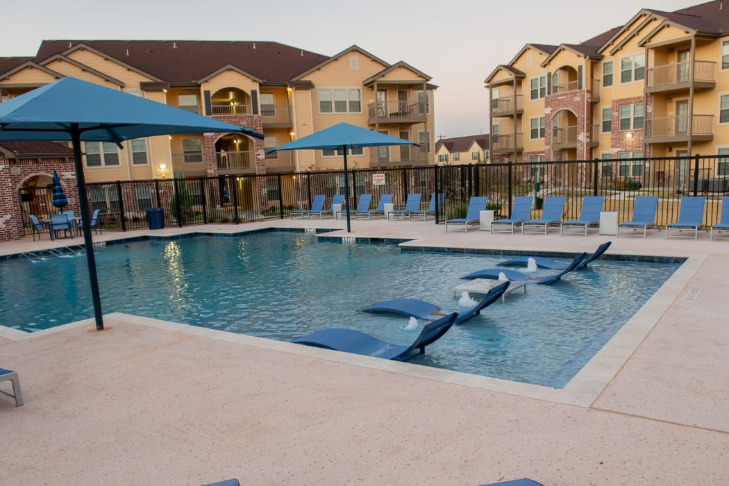 Beautiful pool for residents to enjoy at Portico at Friars Creek Apartments in Temple, Texas