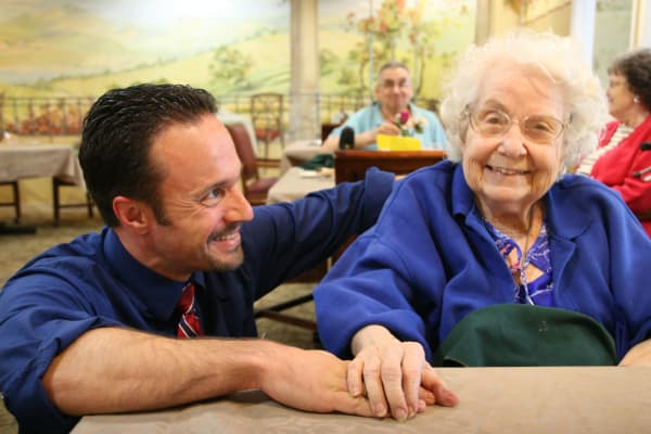 A caretaker with a senior at Peters Creek Retirement & Assisted Living in Redmond, Washington
