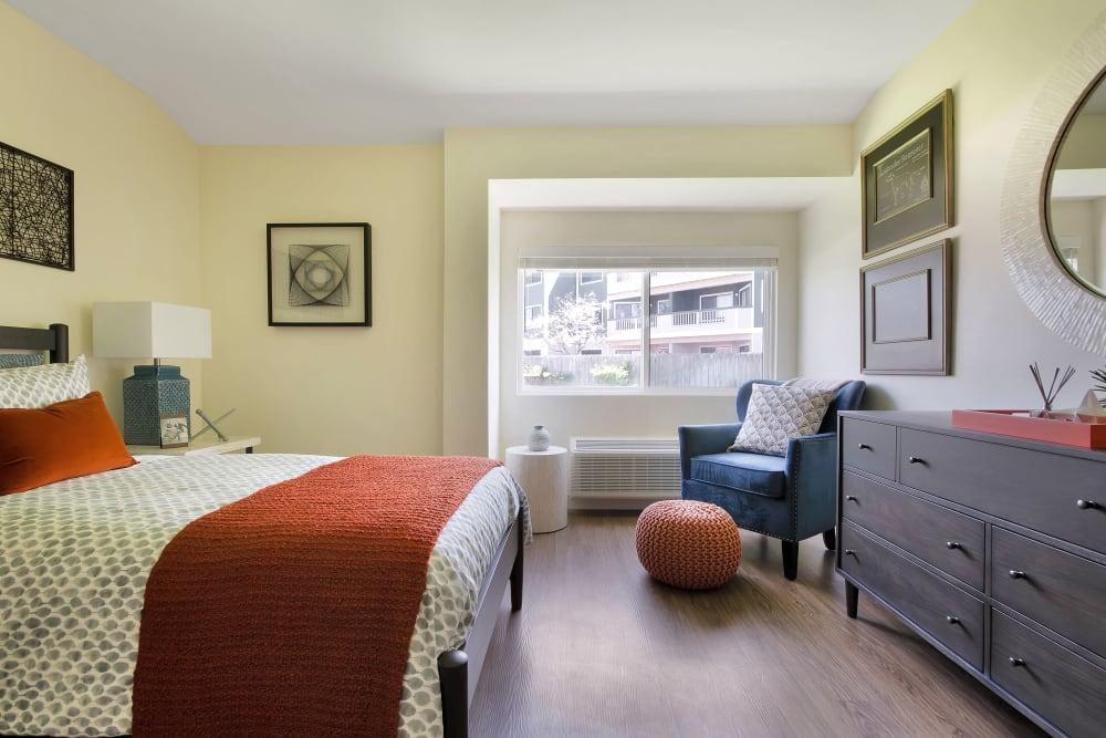 Resident bedroom with hardwood floors at Madonna Gardens in Salinas, California.