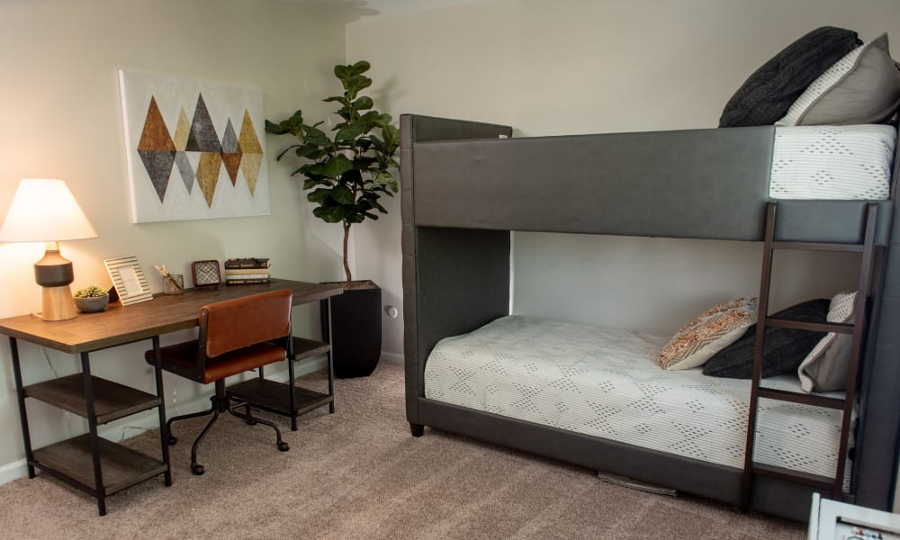 Bedroom with bunk beds at Mandalane Apartments in Wheeling, Illinois