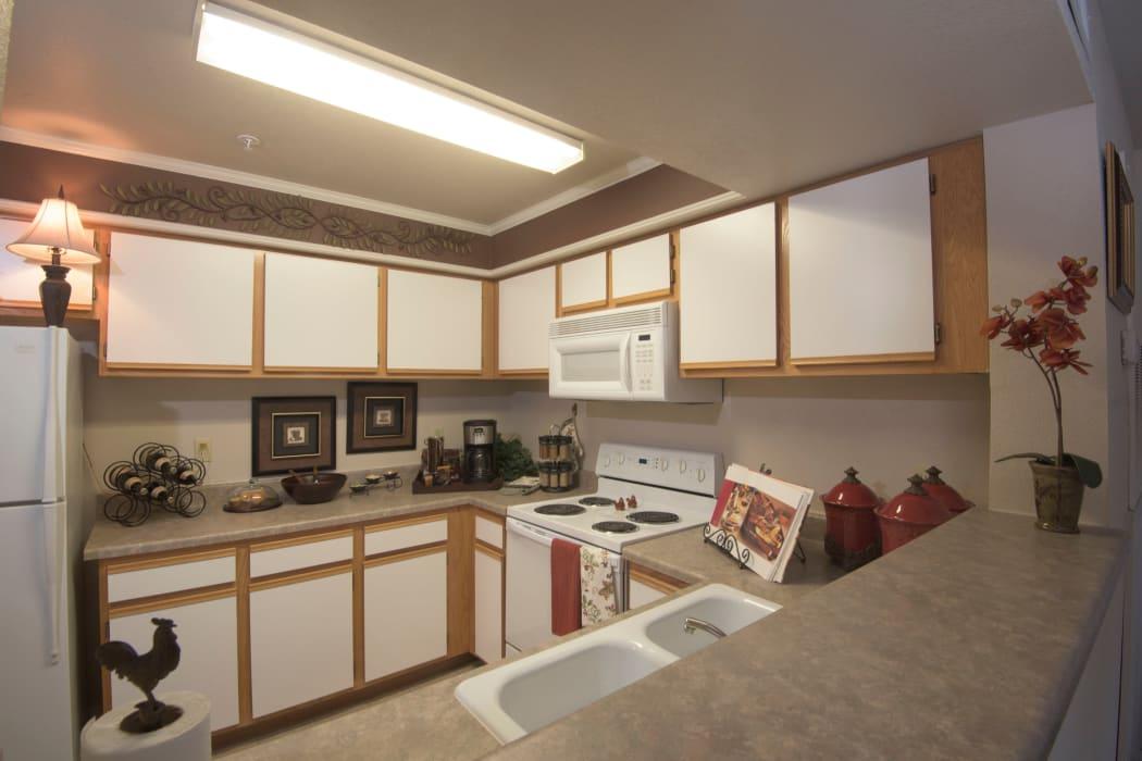 Kitchen with white appliances at Newport Wichita in Wichita, Kansas
