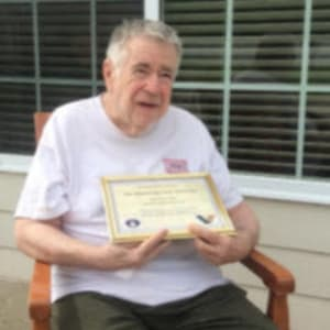 Resident Jim recognized for his service at Courtyard Estates at Cedar Pointe in Pleasant Hill, Iowa.