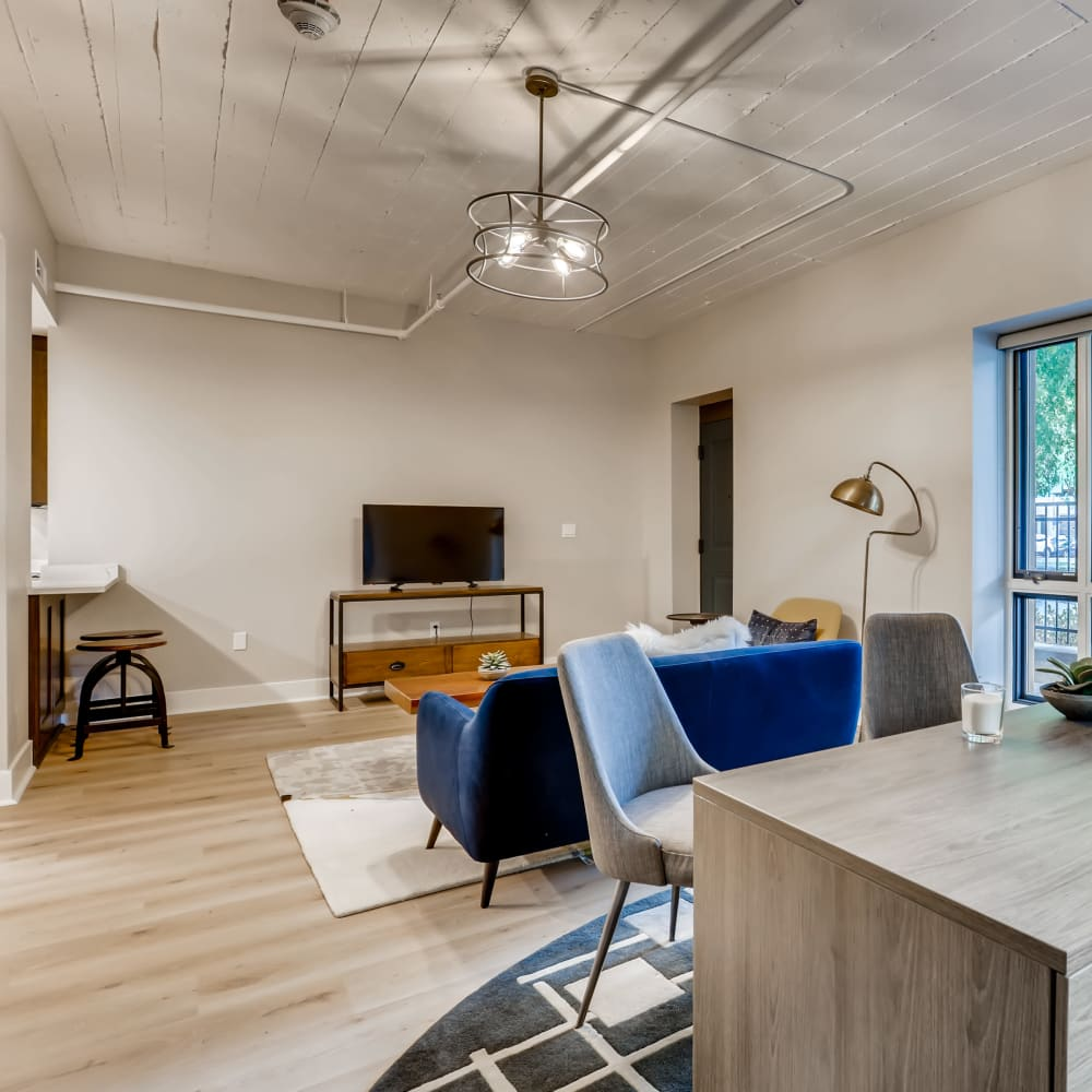 Living room with a desk area at The Mill at First Hill in Seattle, Washington
