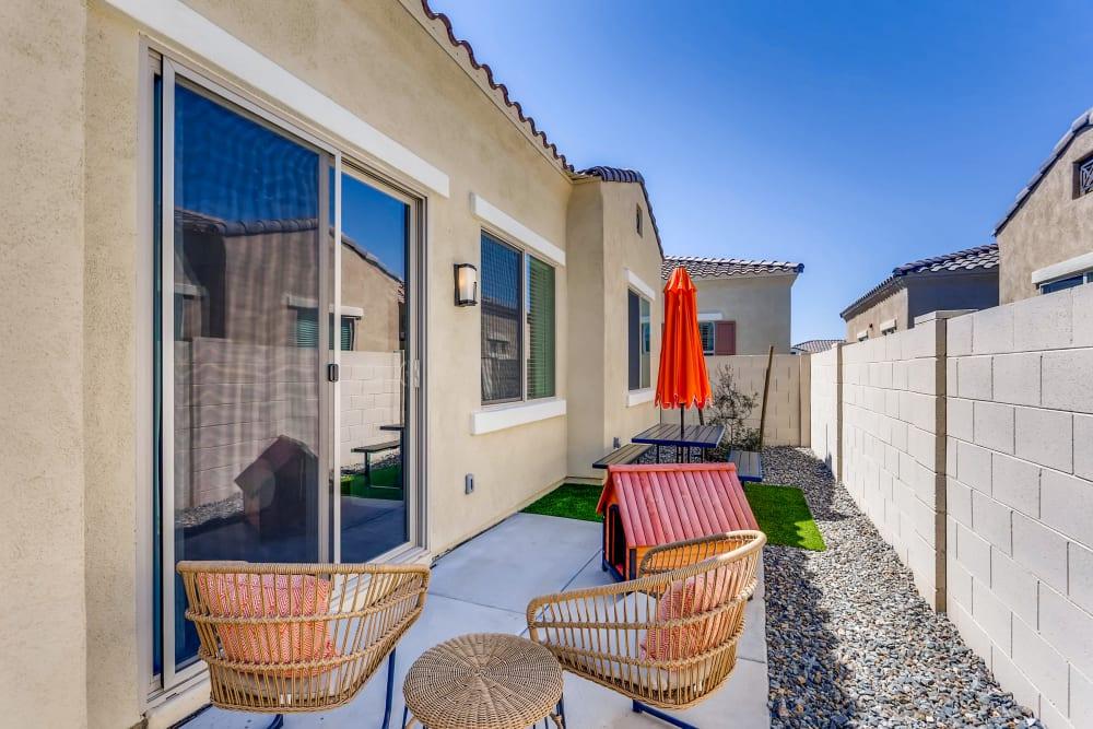 Avilla Camelback Ranch apartment featuring a backyard patio.