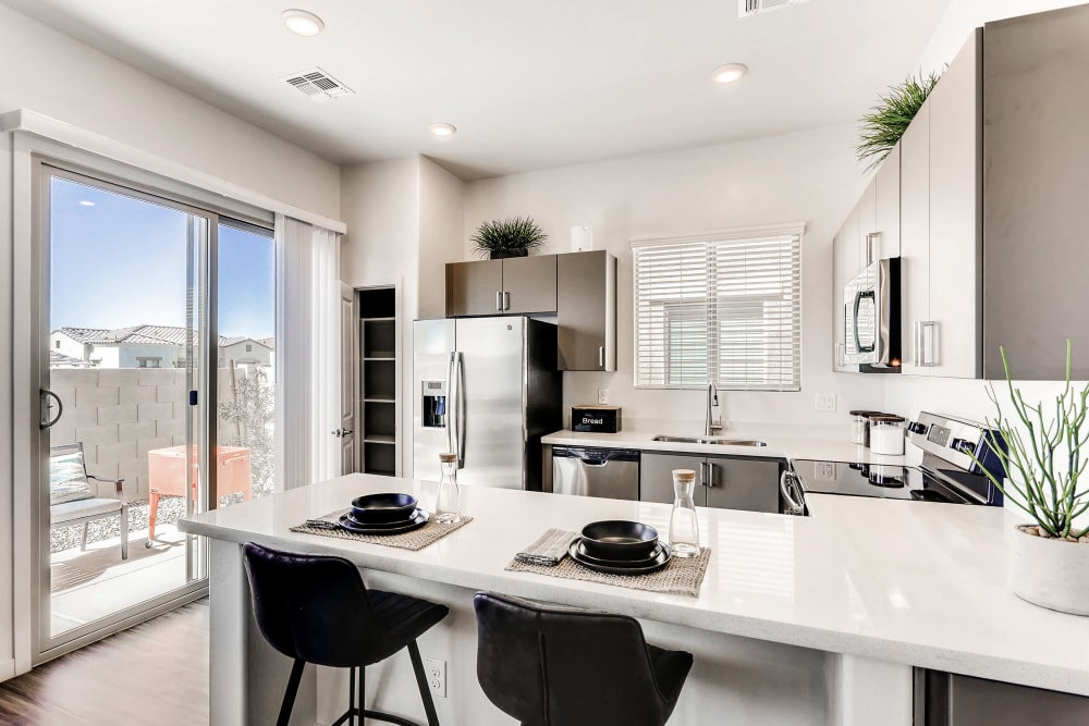 Kitchen with view to the outdoors at Avilla Camelback Ranch in Phoenix AZ